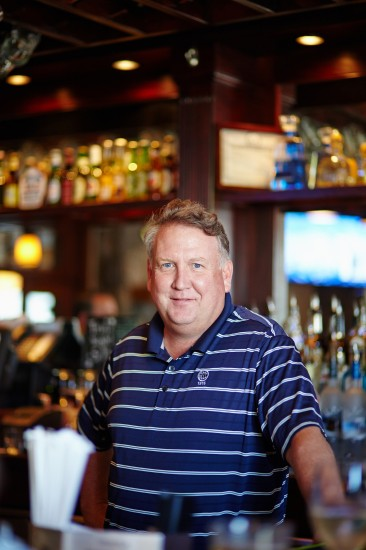 Owner Jack Heneghan stands behind the bar at JA Heneghan's.